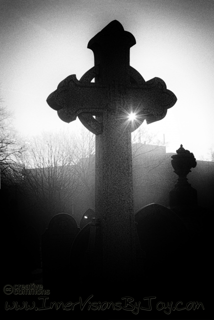 Celtic grave marker at sunet in black and white