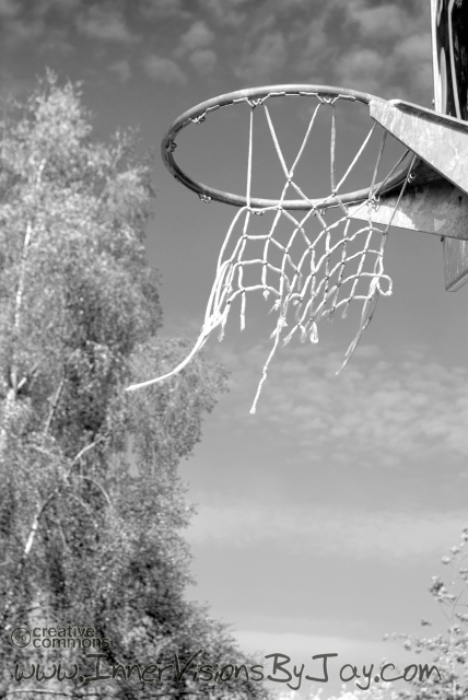 Tattered basketball net in black and white post-apocalyptic image