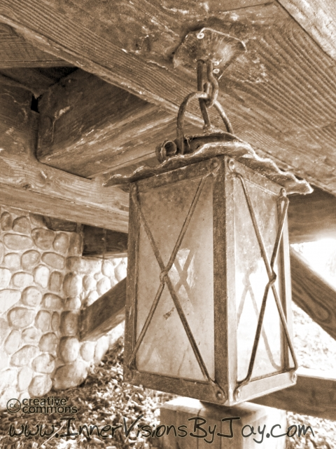 Antique lantern below a decommissioned railway