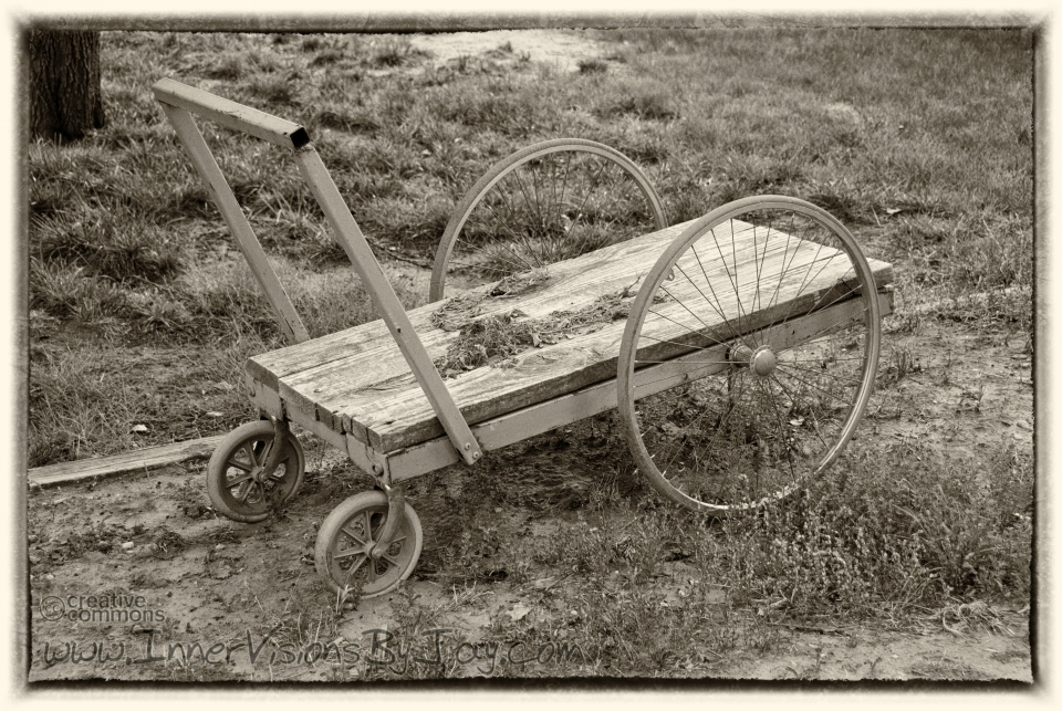 Abandoned antique pushcart in sepia