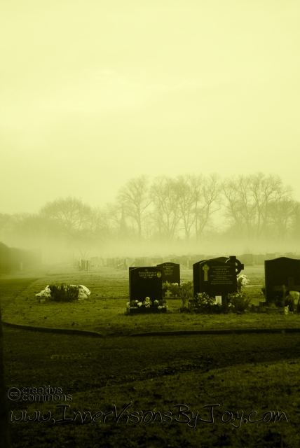 Mist Immemorial - Yellow-toned graveyard with morning mist covering tombstones
