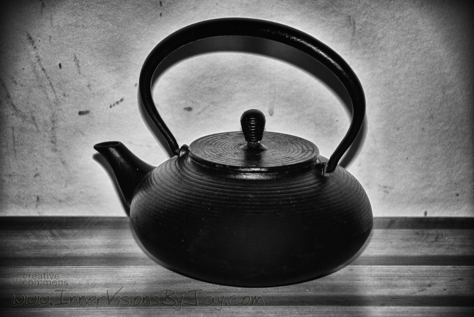 Cast iron teapot in black and white